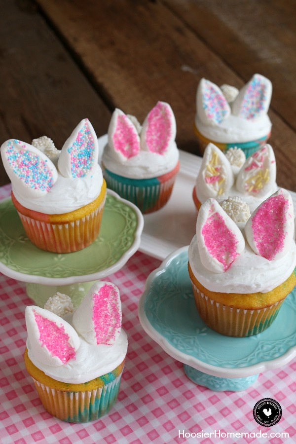 Marshmallows on top of vanilla cupcakes cut to look like bunny ears with pink sprinkles
