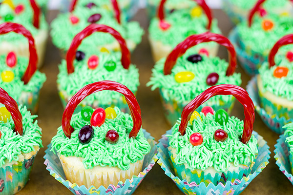 Cupcakes Decorated to look like Baskets filled with Eggs
