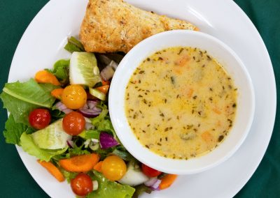Corn Chowder, Seasonal Salad, Herb Scone, and Seasonal Fruit