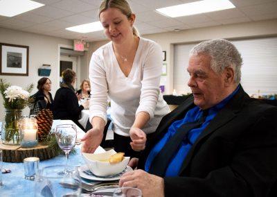 Woman serving a man soup