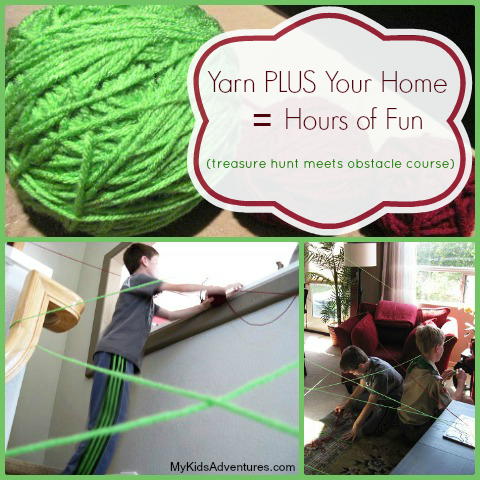 A child follows a green string of yarn, arranged like a maze, around the living room