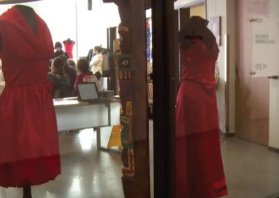 2 red dresses in a window display