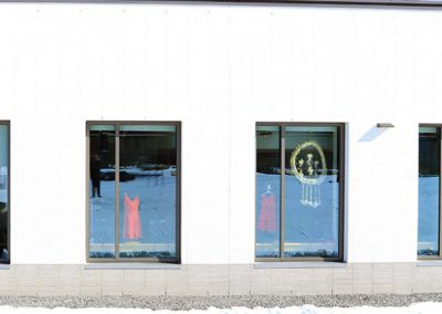Red dresses in windows