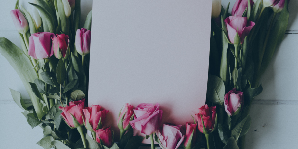 roses surrounding a blank piece of paper