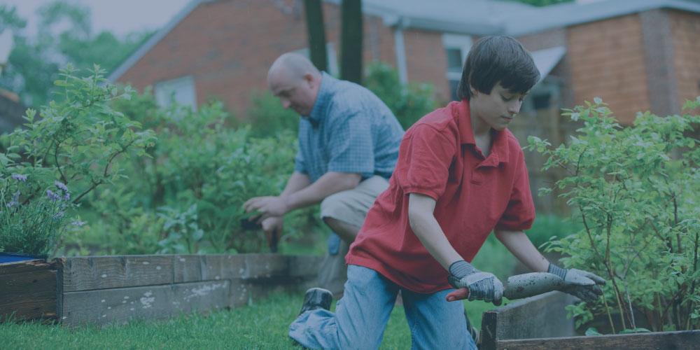 man and boy gardening