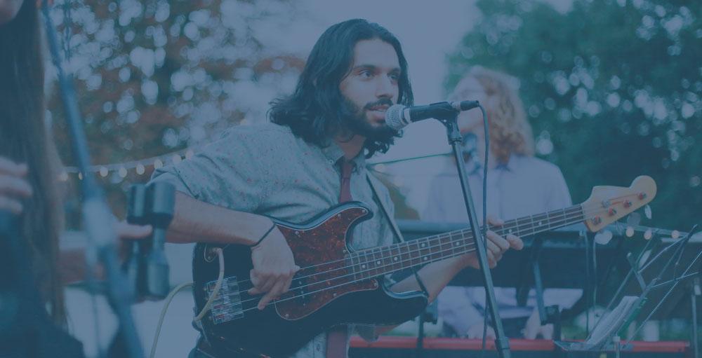 man playing an electric bass guitar