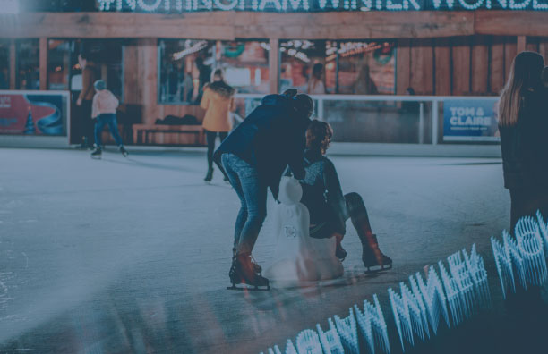 2 people skating in an outdoor arena